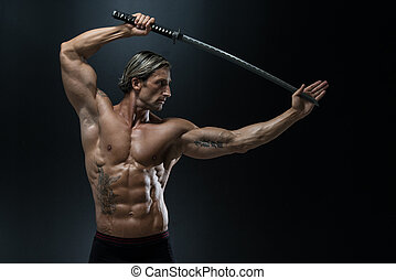 Muscled Male Model In Studio With A Sword - Portrait Of A...