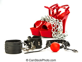 Fetish stuff: hand cuffs, mask, whip and extreme high heels...