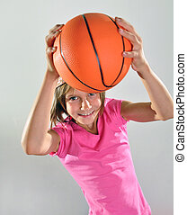 young basketball player makes a throw - young basketball...