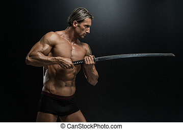 Mature Man Holding Sword Ready To Fight - Portrait Of A...