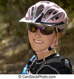 Young Woman Mountain Biking