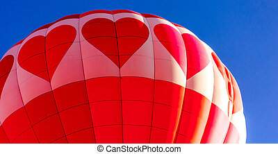 Hot Air Balloon Festival - Close up of red and pink heart...