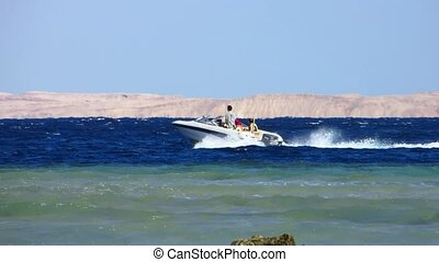 Motor boat - Motorboat moves by Red sea