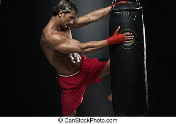 Shirtless Muscular Boxer With Punching Bag In Gym - A Man...