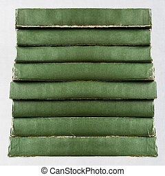 stack of old books - green vintage old books isolated on...