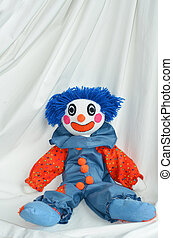 Handmade clown doll sit on white background Concept photo of...