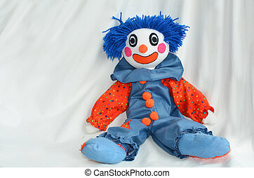 Handmade clown doll sit on white background. Concept photo...