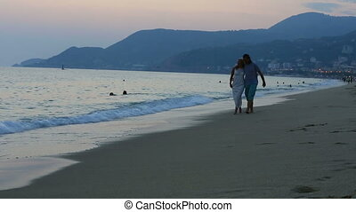couple walking on the beach togethe
