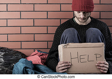 A homeless man need money and asks for help