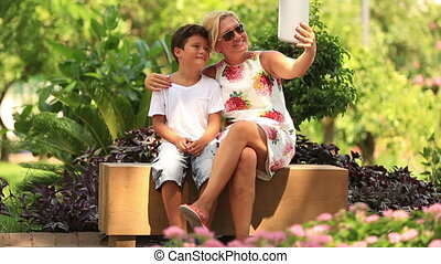 mother and son taking selfie - mother and son taking self...