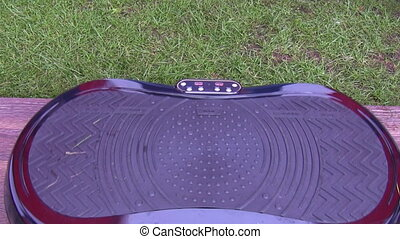 Vibrating plate for exercising - Man is testing vibration...