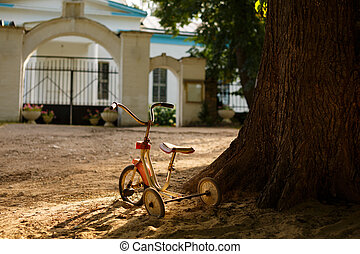Old tricycle - Old children's tricycle rusty bicycle stands...