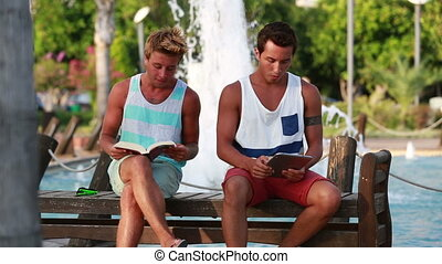 Two young man sitting