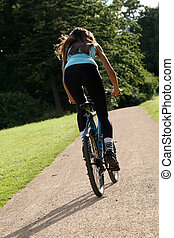 Woman biking on the road