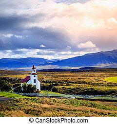 Landscape with church - A traditional Icelandic church near...