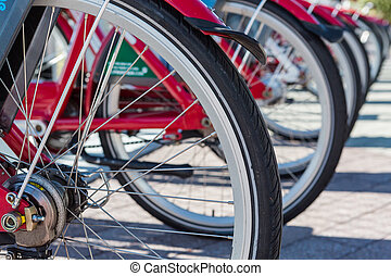 Rental bikes - Row of red rental bikes in downtown Denver,...