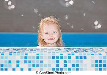 Happy little blond girl