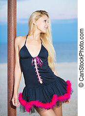 Sexy blond woman in black peignoir