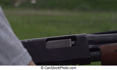 Reload Gun - Empty case with gunpowder smoke emitted from a...