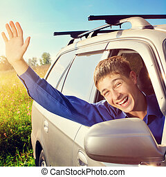 Teenager in a Car - Toned photo of Happy Teenager sit in the...