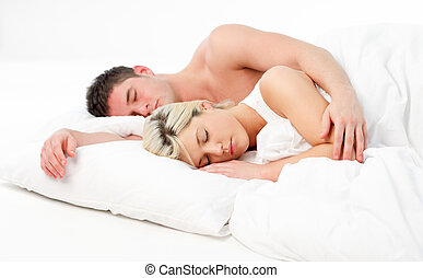 Beautiful girl sleeping with her boyfriend in bed