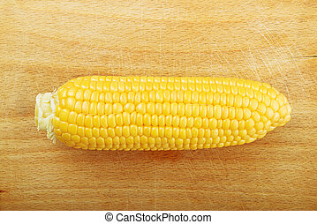 Corn Maize Cob on wooden background - Beautiful fully...