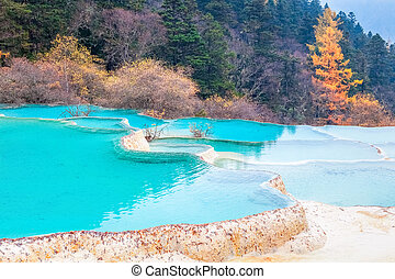 beautiful clear water with blue calcification pond ,...