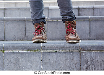 Male leather boots on steps - Close up male leather boots on...