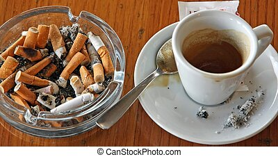 cup of coffee espresso and ashtray chock full