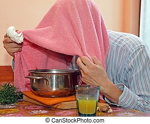 man with towel breathe balsam vapors to treat colds and the...