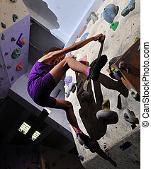 Child exercising and rock climbing - Little girl exercising...