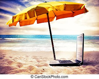 Vacation time - Concept of vacation time with a laptop on...