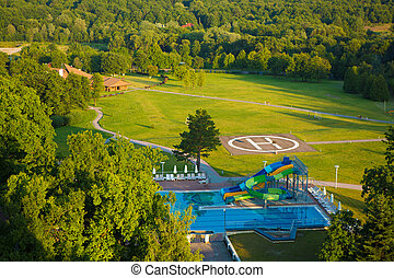 peak helipad under sunset - peak helipad and swimming pool...