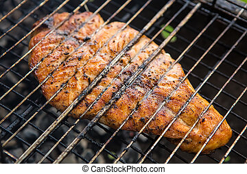 Fish char-grilled over flame