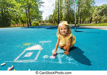 Blond girl play with chalk - Happy little blond girl drawing...