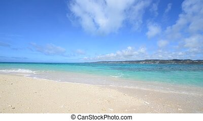 Summertime at the beach - The cobalt blue sea and blue sky...