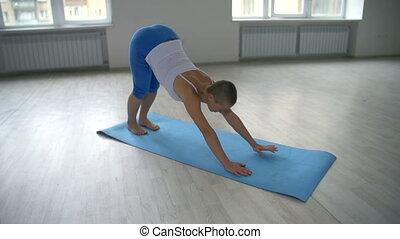 Side Angle Plank - Bald yogi performing side angle plank...