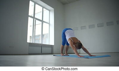 Vasisthasana Variation - Tranquil woman doing downward...