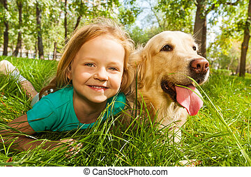 Little blond girl with her retriever dog - Funny wide angle...