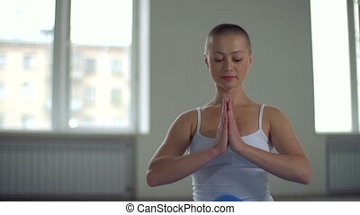 Serenity and Balance - Close up of skinhead woman sitting in...