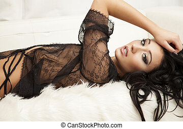 Young slim sexy woman in lingerie on the white fur - Young...