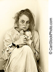 Mentally ill - Woman in a psychiatric ward with two dolls.