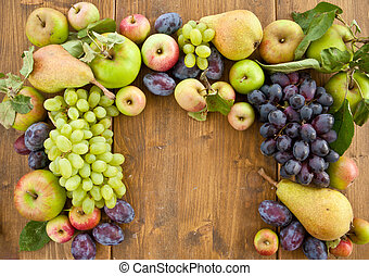 Fresh autumn fruits - Colorful fresh autum fruits on rustic...