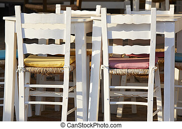 Traditional white wooden chairs in Crete. Greece