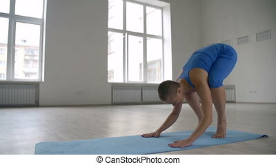 Pendant Pose - Girl practicing advanced yoga exercise