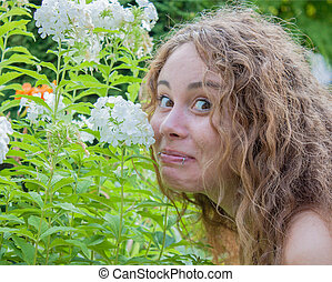 lady smelling a flower