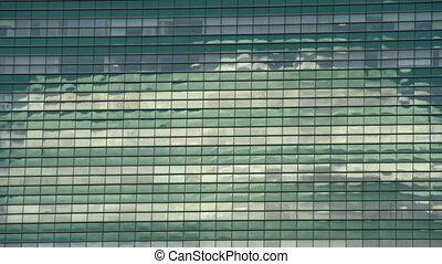 Reflection in a Skyscraper - Quickly running clouds...