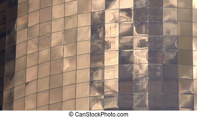 Reflections in Windows - Quickly running clouds reflected in...