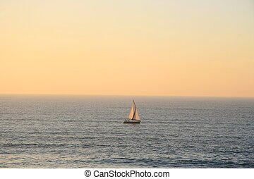 ship on sea  - A ship over a open sea and pretty sunset
