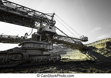 a huge mining machine - a huge working dredge in a mine